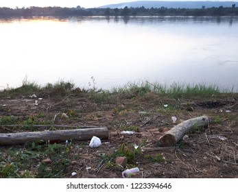 Rubbish pollution with plastic,foam and other stuff on the riverbank of Khong river in Nongkhai province,northern Thailand.Pollution concept.Dirty concept.