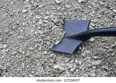 rubble and a black shovel