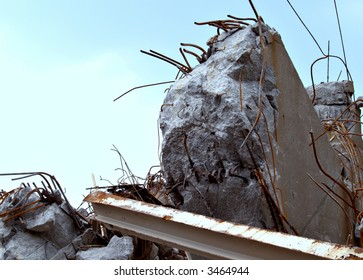 The rubble, debris, and twisted metal of a collapsed bridge