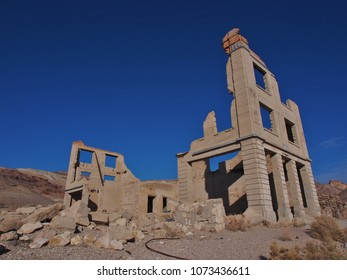 Rubble of an Old Collapsed Concrete Building, Still Partially Standing, Against a clear blue sky, Isolated Building, Located in an Old Historic Town