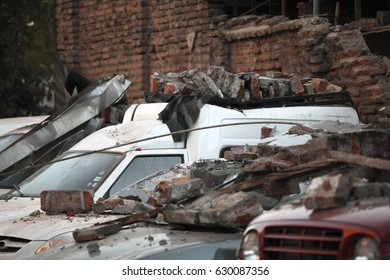Rubble over cars during an earthquake in Chile.