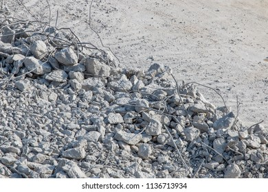 Rubble pile on the construction site. Demolition of the building.