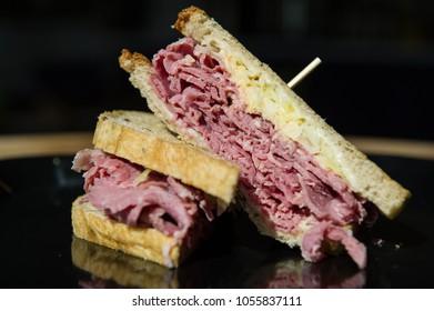 ruben sandwich against black background