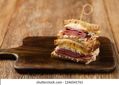 Ruben sandwich. New York sandwich with pastrami, sauce 1000 islands and sauerkraut. Front view. Fast food.