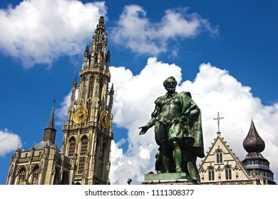 Rubens statue and the Antwerp Cathedral with soft clouds in summer. Belgium