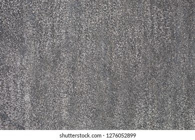 Ruberoid. Abrasive texture roofing material close-up. Abstract dark granular background.