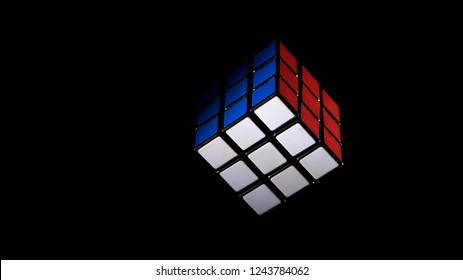 Rubics Cube showing red white and blue for patriotism or puzzle. image is offset to allow text