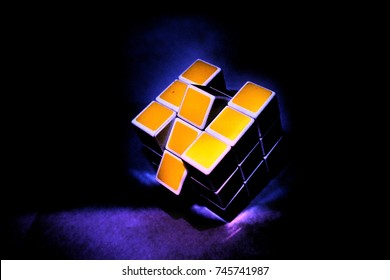 Rubik's cube on neon glow. Rubik's Cube invented by a Hungarian architect Erno Rubik in 1974.