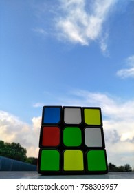 Rubik's Cube on sky and clouds  background. Rubik's Cube invented by a Hungarian architect Erno Rubik in 1974.