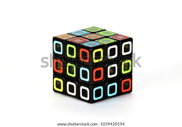 The Rubik`s cube on the white background. The solution sequence stage one, beginig. The object is isolated on white and a clipping path is provided for easy extraction.