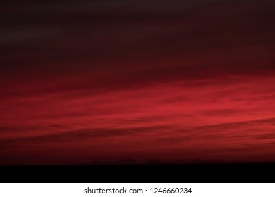 Rubin red sky during sunrise in Sahara desert