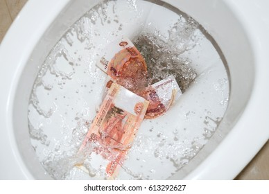 rubles are washed down the drain through the toilet