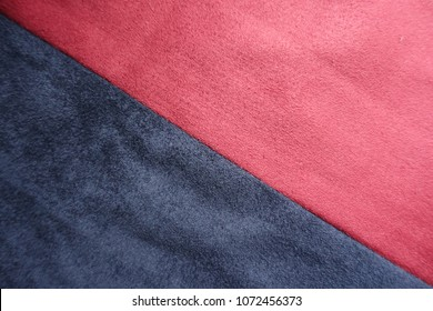 Ruby red and dark blue artificial suede sewn together diagonally