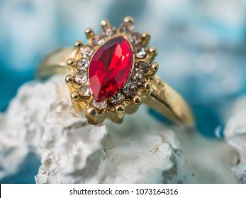 Ruby ring in gold setting with little diamond  setting around ( a costume ring)