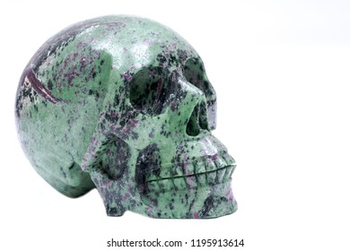 Ruby Zoisite realistic crystal carved skull isolated on white background