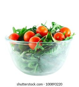 Rucola ,Chard and cherry tomatoes salad in transparent bowl isolated on white