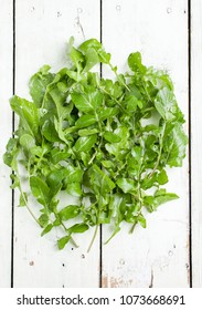 rucola on a white wooden table. Top view
