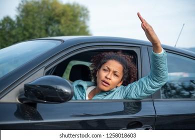 Rude black woman driver arguing and driving car
