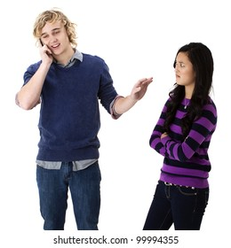 Rude young man on his cell phone puts up his hand to quiet his angry girlfriend