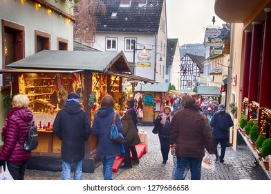 RUDESHEIM, GERMANY - DEC 18, 2018 - Visitors drink gluwein on a winter afternoon at the Christmas market,Rudisheim, Germany