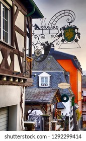 RUDESHEIM, GERMANY - DEC 18, 2018 -Traditional signs on half timbered houses in Rudisheim, Germany