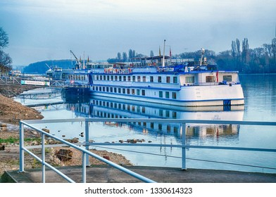 RUDESHEIM, GERMANY - DEC 18, 2018 - River cruise ship docked at sunset near Christmas market,Rudisheim, Germany