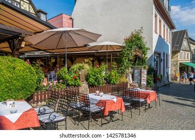 Rudesheim, Germany - July 07, 2018: Tables of the street cafe in Rudesheim