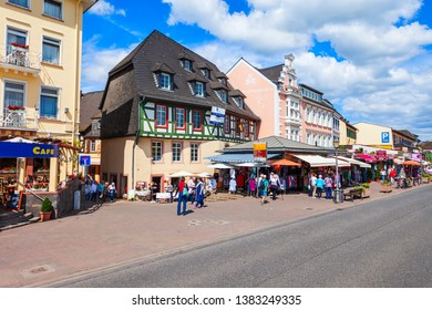 RUDESHEIM AM RHEIN, GERMANY - JUNE 25, 2018: Rudesheim city centre, winemaking town in the Rhine Valley in Germany.