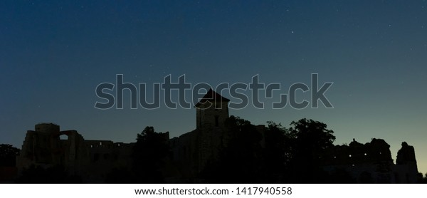 RUDNO, POLAND - JUNE 3, 2019: Night view on the Tenczyn Castle
