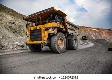 Rudny/Kazakhstan - May 14 2012:  Open-pit mining iron ore in quarry. Caterpillar quarry trucks transporting ore to concentrating plant.