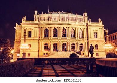 Rudolfinum - Czech philharmonic in Prague, Czech republic. Night scene. Travel destination. Architectural scene. Red photo filter.