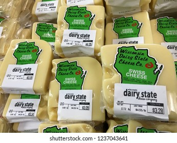 Rudolph, Wisconsin/USA - November 21, 2018. Fresh Swiss cheese on display the day before Thanksgiving at a cheese making company in Wisconsin.