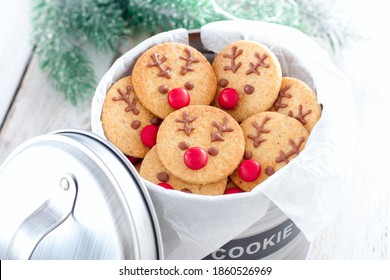 """Rudolph's Christmas cookies in a metal jar with the inscription """"Cookie"""", selective focus"""
