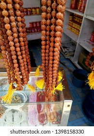 Rudraksh mala (Rosary) Beads, seed. Rudraksh Chain for sale in Ayodhya India. Typically used by the hindu sadhus. Rudraksh background and texture.