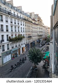 Rue des Abbesses, Paris, France - October 1, 2018: view of Rue des Abbesses, early morning, blue sky