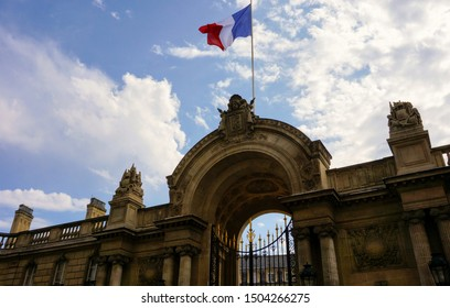 Rue du Faubourg Saint-Honoré, Paris, France - Portal of the official entrance of the Élysée Palace, seat of the Presidency of the French Republic, flying a French flag