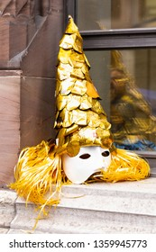 Ruedengasse, Basel, Switzerland - March 13th, 2019. Close-up of a beautiful golden carnival mask
