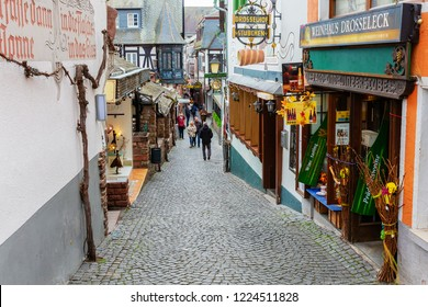 Ruedesheim am Rhein, Germany - April 05, 2018: famous Drosselgasse with unidentified people. The Drosselgasse with old wine taverns becomes visited by about 3 millions tourists a year