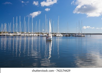 Ruegen Island,Germany: September 27,2015: White yachts in the harbor on the Ruegen Island. Ruegen is Germanys largest island by area. It is located off the Pomeranian coast in the Baltic Sea