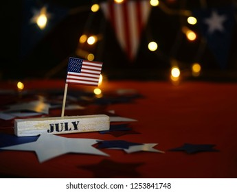 Ruffled American flag and wooden cube calendar with 4th of July, USA Independence Day date, copy space celebratory background. US patriotic festive composition, close up, concept, holiday, patriotism