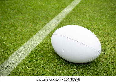 rugby ball near try line on rugby pitch with copy space