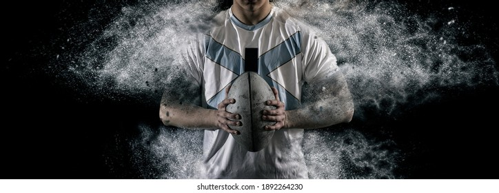 Rugby football player holds ball. Sports banner. Horizontal copy space background