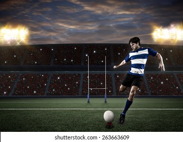 Rugby player in a blue uniform kicking a ball on a stadium.