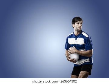 Rugby player in a blue uniform on a blue background.