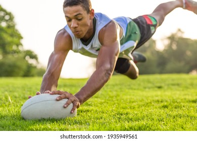 Rugby player diving for the ball in the air action.