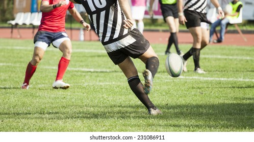 Rugby player kicking the oval ball