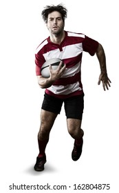 Rugby player in a red uniform running. White Background