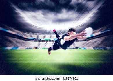 Rugby player scoring a try against rugby stadium