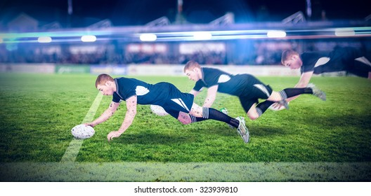 A rugby player scoring a try against pitch