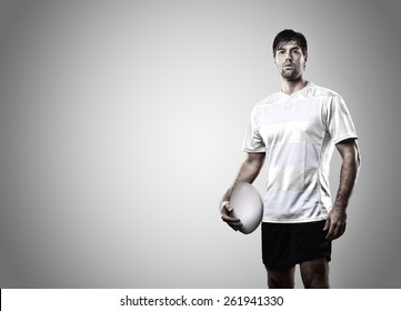 Rugby player in a white uniform on a white background.